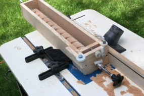 Hastily Created Jig For Routing Spiral Trim Patterns.  The Wood Blank Rotates as the Jig Slides Along Fence